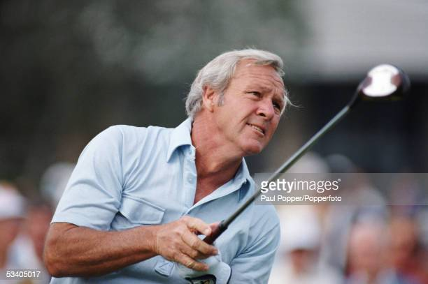 American professional golfer Arnold Palmer follows the progress of his tee shot during competition in the Bay Hill Classic golf tournament at the Bay...