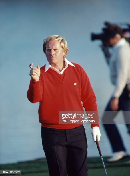 American professional golfer Jack Nicklaus demonstrates how close his tournament winning missed putt was from the hole during play in the final round...