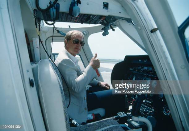 American professional golfer Jack Nicklaus gives a thumbs up sign as he sits in a helicopter prior to take off in the United States in April 1989