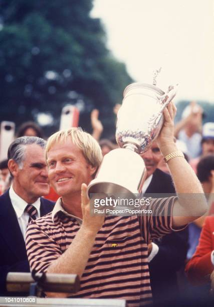 American professional golfer Jack Nicklaus holds the trophy in the air after finishing in first place to win the 1980 US Open golf championship on...