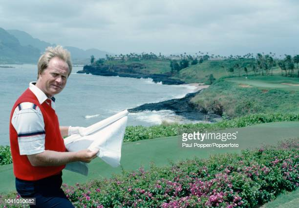 American professional golfer Jack Nicklaus pictured holding plans for a new golf course at Kauai Lagoons Golf Club in Hawaii United States in April...
