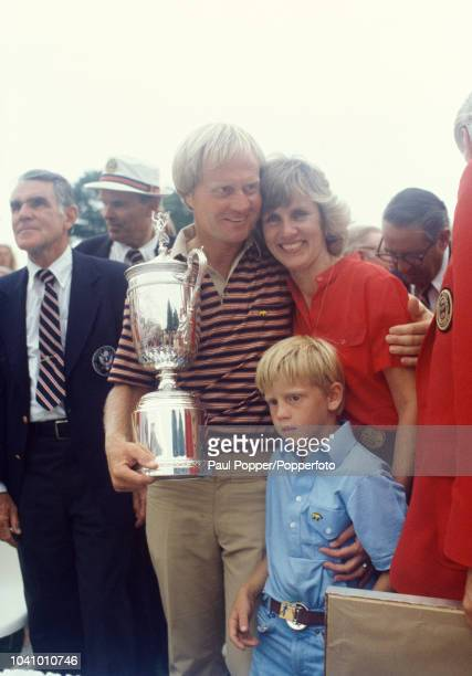 American professional golfer Jack Nicklaus pictured holding the trophy with his wfe Barbara Nicklaus and son Michael Nicklaus after finishing in...