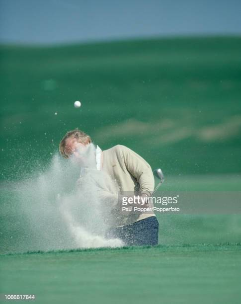 American professional golfer Jack Nicklaus shoots out of a bunker during the Honda Classic golf tournament at the TPC Eagle Trace Golf Club in Coral...