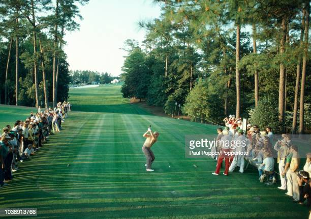 American professional golfer Jack Nicklaus tees off on the 18th hole, watched by David Graham and Greg Norman of Australia during play in the 1981...