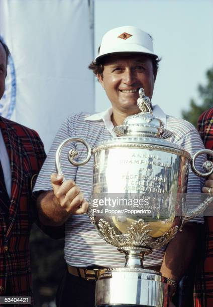 American professional golfer Raymond Floyd holds up the Wanamaker Trophy after finishing in first place to win the 1982 PGA Championship golf...