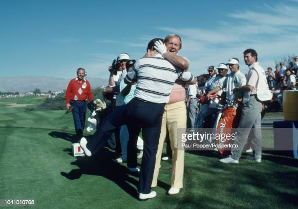 American professional golfers Jack Nicklaus and Fuzzy Zoeller embrace on a green after playing a great shot during competition in the 1987 Skins Game...