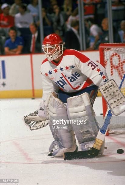 American professional hockey player Bob Mason goalie for the Washington Capitals tends the goal during warmup before a home game at the Capital...