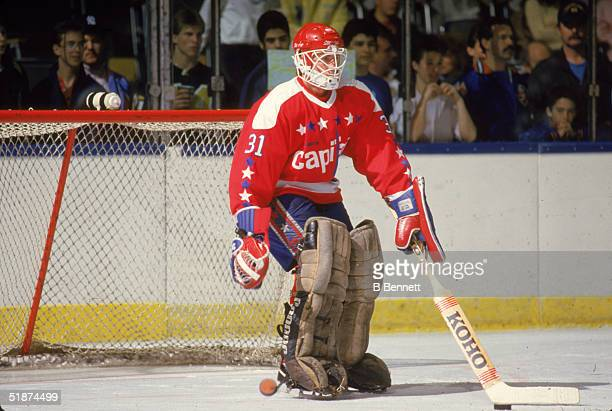 American professional hockey player Bob Mason goalie for the Washington Capitals tends the goal during warmup before a road game against the New York...
