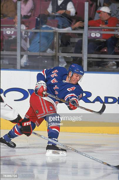 American professional hockey player Brian Leetch defenseman for the New York Rangers skating against the Buffalo Sabres October 7 2001