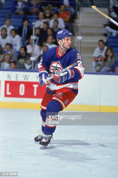 American professional hockey player Dave Ellett defenseman of the Winnipeg Jets skates on the ice during a road game against the New York Islanders...