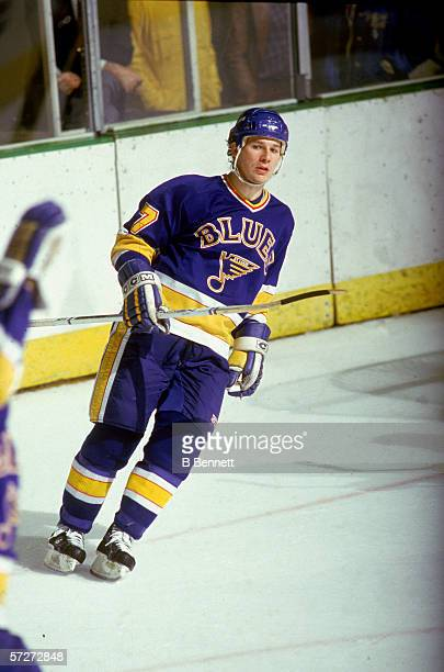 American professional hockey player Joe Mullen forward for the St Louis Blues skates on the ice during a road game early to mid 1980s