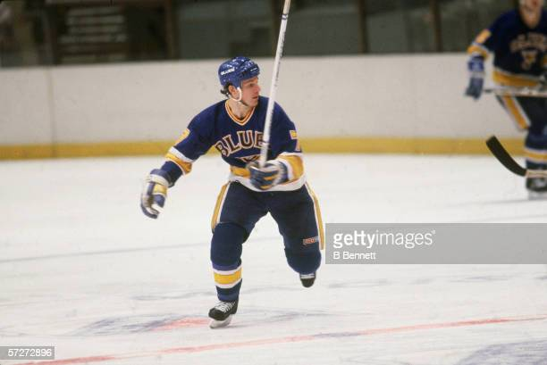 American professional hockey player Joe Mullen forward for the St Louis Blues skates on the ice during a game with the New York Rangers at Madison...