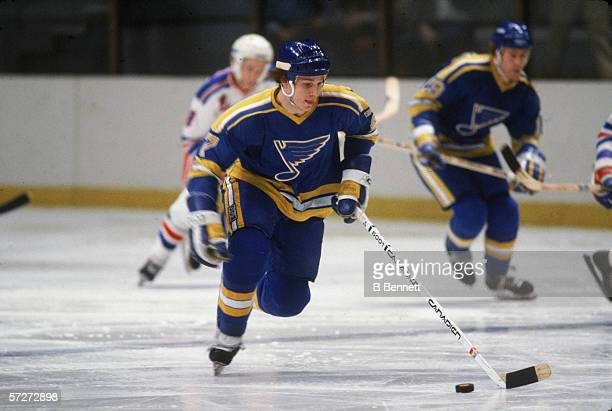American professional hockey player Joe Mullen forward for the St Louis Blues follows the puck during a game with the New York Rangers at Madison...