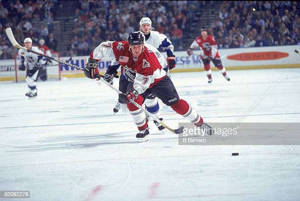 American professional hockey player Keith Tkachuk skates on the ice as a member of the North American All Star team at the 1999 NHL All Star Game Ice...