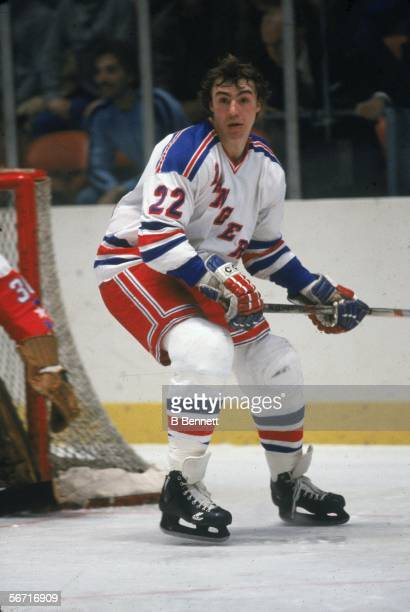 American professional hockey player Nick Fotiu of the New York Rangers skates on the ice without a helmet near the goal during a home game Madison...