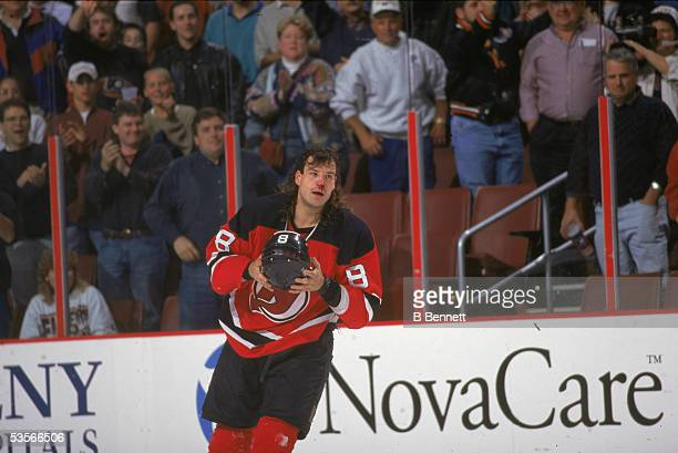 American professional hockey player of the New Jersey Devils skates with a bloody nose after a fight during a road game against the Philadelphia...