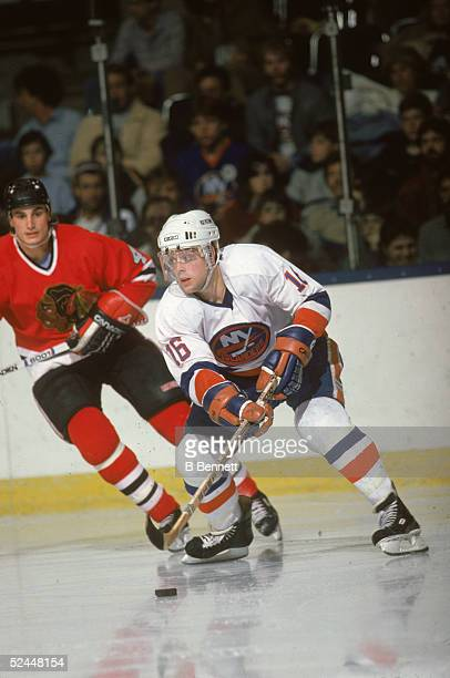 American professional hockey player Pat LaFontaine of the New York Islanders controls the puck during a home game at Nassau Coliseum Uniondale New...