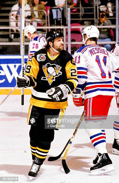 American professional hockey player Phil Bourque of the Pittsburgh Penguins celebrates a goal during a game against the New York Rangers at Madison...