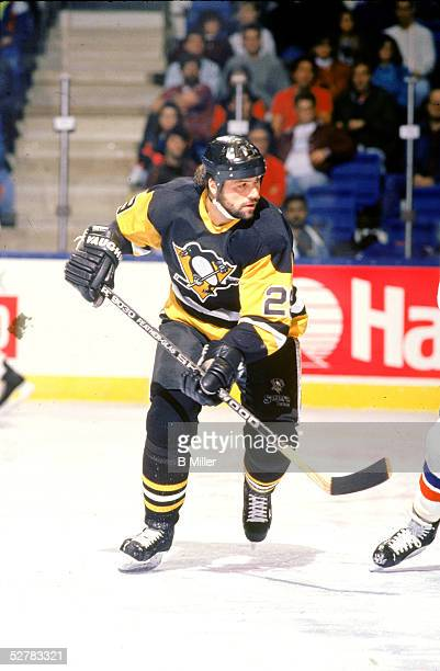 American professional hockey player Phil Bourque of the Pittsburgh Penguins in action during a game against the New York Islanders at Nassau Coliseum...