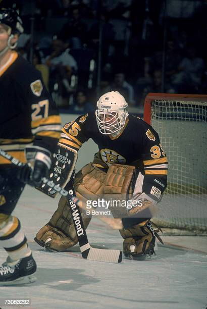 American professional ice hockey player Cleon Daskalakis goalie of the Boston Bruins defends the net during an away game against the New York...