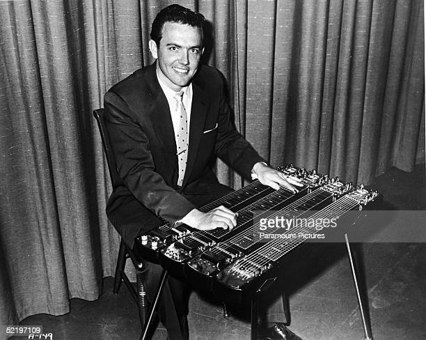 American professional musician Ernie Ball pioneer maker of rock roll guitar strings called 'Slinkys' which he developed in 1962 plays the pedal steel...