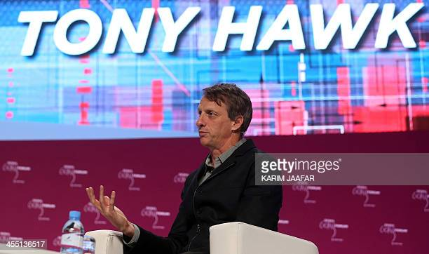 American professional skateboarder Tony Hawk talks during the Doha Goals summit in the Qatari capital on December 11 2013 Sports ministers from all...