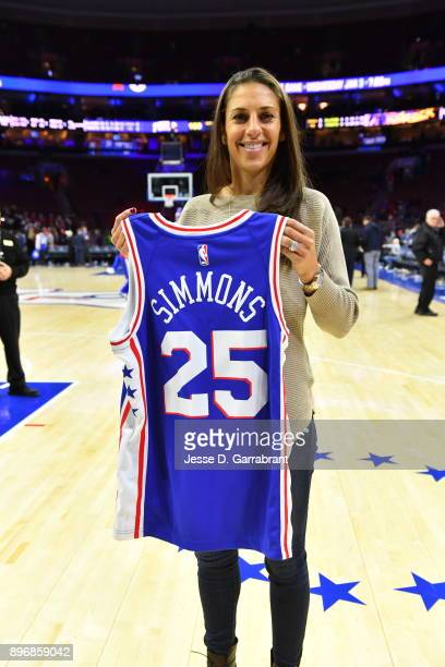 American professional soccer player Carli Loyd attends the Philadelphia 76ers game while holding a Ben Simmons Jersey against the Toronto Raptors at...