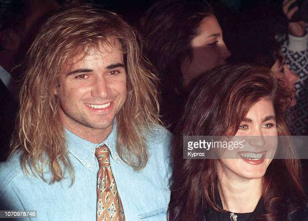 American professional tennis player Andre Agassi with an unknown woman attends a red carpet event US March 1990
