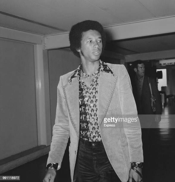 American professional tennis player Arthur Ashe arrive at Heathrow Airport, London, UK, 26th June 1973.