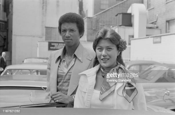 American professional tennis player Arthur Ashe with Lois Wise in London, UK, 22nd June 1976.