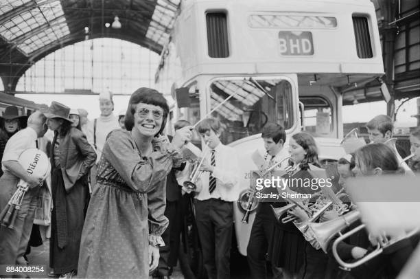 American professional tennis player Billie Jean King conducting a school band who met tennis players at Brighton Station UK 6th May 1971