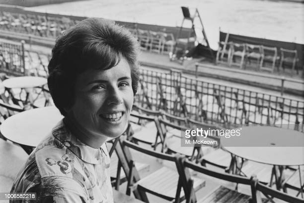 American professional tennis player Billie Jean King pictured seated in the stands at Queen's Club in West Kensington London on 17th June 1965