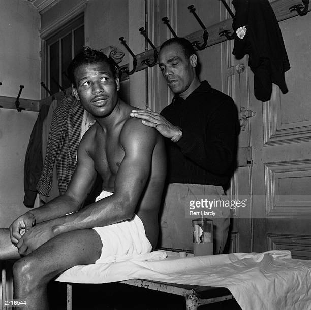 American professional welterweight and middleweight boxer Sugar Ray Robinson being massaged before a contest with British boxer Randolph Turpin...