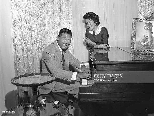 American professional welterweight and middleweight boxing champion of the world Sugar Ray Robinson poses at home for the CBS celebrity interview...