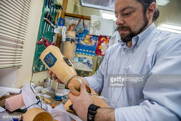 American prosthetist Chris Fantini finishing bionic limb for Vasyl Pelysh during Ukraine Prosthetic Assistance Project Vasyl lost his hand in...