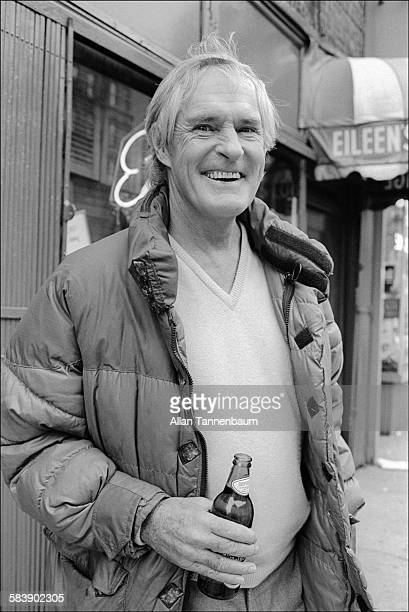 American psychologist Dr Timothy Leary holds a bottle of Heineken beer outside the Nova Convention in the East Village New York New York December 2...