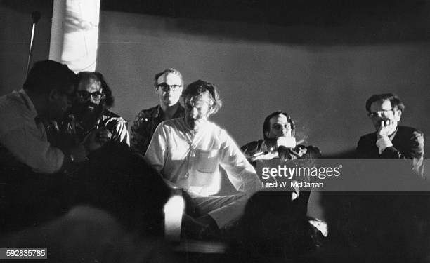 American psychologist Dr Timothy Leary sits on the stage at the Village Gate as he hosts his multimedia presentation 'The Reincarnation of Christ'...