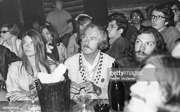 American psychologist Dr Timothy Leary sits with others during an unidentified event at the Village Gate New York New York March 11 1968
