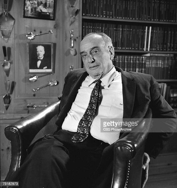 American public official and city planner Robert Moses sits in his office during an interview for 'The Twentieth Century' a television documentary...