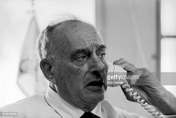 American public official and city planner Robert Moses speaks on the phone in his office New York New York August 1962