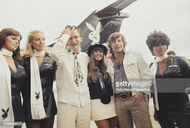 American publisher and owner of Playboy magazine Hugh Hefner pictured third from left with girlfriend Barbi Benton film director Roman Polanski and...