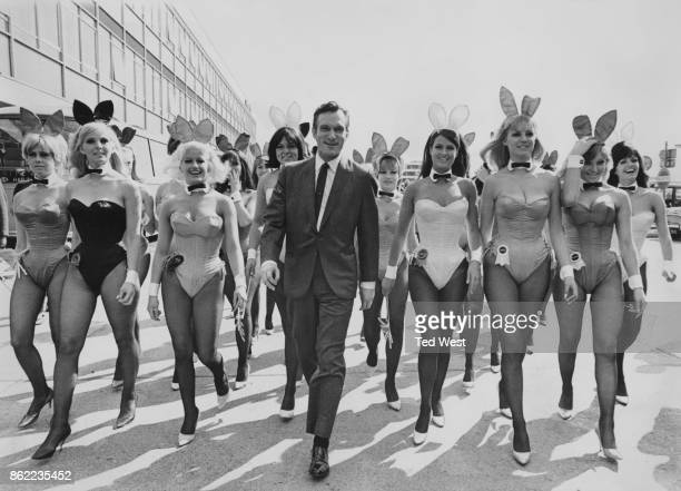 American publisher Hugh Hefner arrives at London Airport from Chicago with an entourage of Playboy Bunnies 26th June 1966 He is in the capital for...