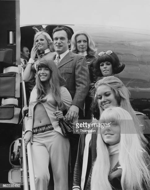 American publisher Hugh Hefner arrives at London Airport in his private DC9 jet airliner 'Big Bunny' with an entourage of Playboy Bunnies and his...
