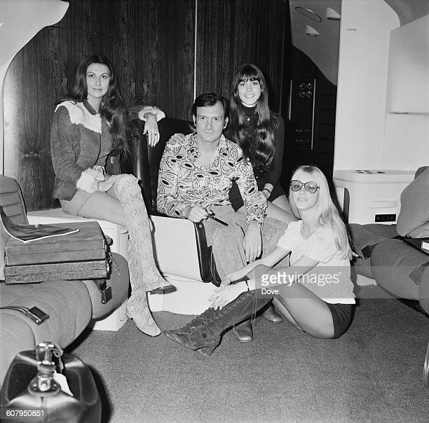 American publisher Hugh Hefner in his aircraft at London Airport before flying back to Chicago 20th February 1971 With him are Playboy models Marilyn...