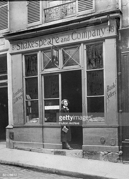 American publisher Sylvia Beach stands in the doorway of her bookshop Shakespeare Company Paris France 1920s Famous for being run by the only person...