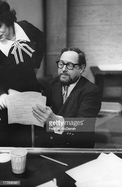 American Pulitzer Prize-winning playwright Tennessee Williams goes over a script with an unidentified woman as he conductions auditions for an...