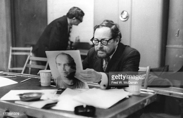 American Pulitzer Prize-winning playwright Tennessee Williams holds an unidentified actor's headshot as he conductions auditions for an unspecified...
