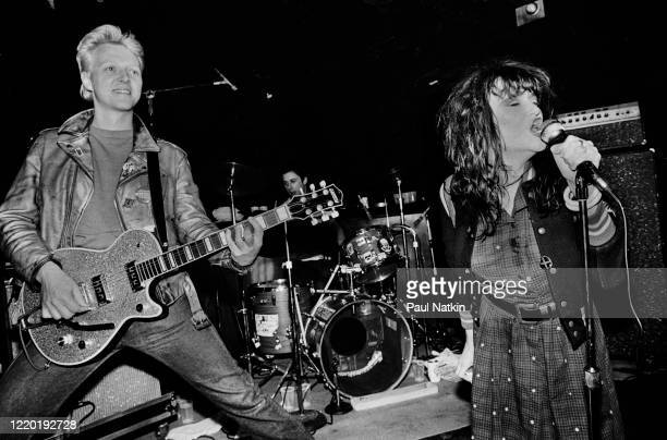 American Punk and Rock musicians Billy Zoom on guitar and Exene Cervenka on vocals both of the group X perform onstage at Exit Chicago Illinois May...