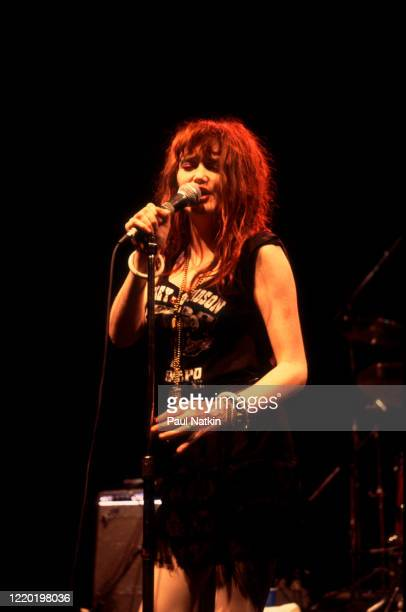 American Punk and Rock singer Exene Cervenka of the group X performs onstage at Tuts Chicago Illinois October 23 1983