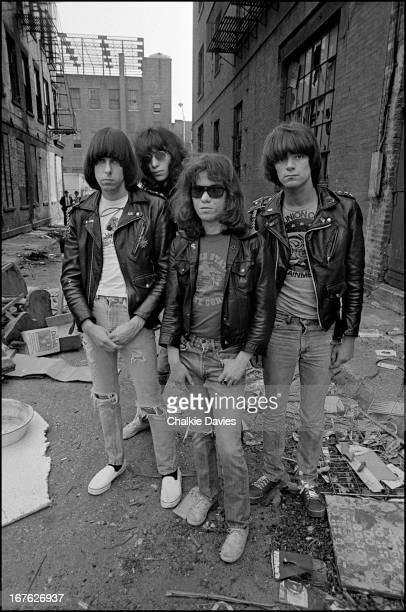 American punk rock group The Ramones in an alleyway off the Bowery New York 1977 Left to right guitarist Johnny Ramone singer Joey Ramone drummer...